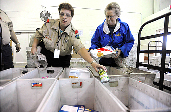 Volunteers Jean Adams (left) of Bangor, a den leader for Bangor Cub Scout Pack 6 and Dorothea Munson of Glenburn, a food manager for Samaritan, Inc.,  helped organize donated food items in mail bins at the United Postal Service's Eastern Maine Processing & Distribution Facility in Hampden Saturday, May 8, 2010. By the end of the day, the food was distributed to area food banks, pantries and shelters. The annual &quotStamp Out Hunger&quot food drive, purported to be the nation's largest one-day food drive, is organized by the National Association of Letter Carriers.  BANGOR DAILY NEWS PHOTO BY JOHN CLARKE RUSS