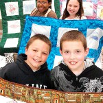 Fourth graders at the Eddington School stand with quilts Friday, May 7, 2010 which they designed, made and will donate to Project Linus and Spruce Run this week. Pictured (left to right, front to back) are Jordan Bragg, 9, Nathan Kane, 10, Sharon Ogbonna, 10, Brooke Seymour, 9, Elizabeth Curtis, 9, Caleigh Lebel, 10, and Dylan Monroe, 10.  BANGOR DAILY NEWS PHOTO BY BRIDGET BROWN