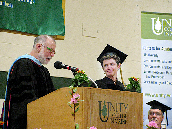 UNITY - Unity College President Mitchell Thomashow introduces commencement speaker and honorary degree recipient Kate Braestrup on Saturday afternoon. Braestrup is a community minister, Maine Warden Service chaplain and the author of the bestselling memoir, Here If You Need Me.   BANGOR DAILY NEWS PHOTO BY ABIGAIL CURTIS