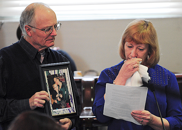 Richard Grindal holds a framed picture of his daughter, Rachel Grindal, on Monday, May 10, 2010 as his wife Rita Grindal reads a prepared statement to the court during the sentencing of Corina Durkee and Earl &quotBuddy&quot Bieler for the murder of their daughter.  BANGOR DAILY NEWS PHOTO BY KEVIN BENNETT