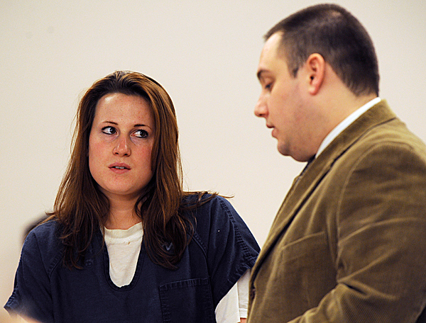 Anjelika Cray (left) listens as her attorney, Joseph Belisle, explains to her that she will not be getting out on bail unless she can raise $500 cash on wednesday at the Penobscot Judicial Center in Bangor. Cray is charged with conspiracy to commit kidnapping. BANGOR DAILY NEWS FILE PHOTO BY KEVIN BENNETT