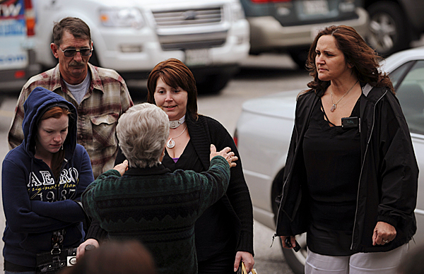 Dorcelle Brown, back to camera, embraces Tracey Neild as she arrives at the Lincoln County Curthouse in Wiscasset on Monday, May 10, 2010. Along with Neild is her father Evan Buckland, second from left, and her cousin Lori Miller, right. The women at the far left is unidentified. Neild was present to offer a victim impact statement during the sentencing of Corina Durkee and Earl &quotBuddy&quot Bieler. Neild had her throat slashed during an attack by the pair on April 19, 2010 at her Waldoboro home.  BANGOR DAILY NEWS PHOTO BY KEVIN BENNETT