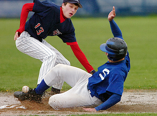 Bangor Christian's Ben Groski (13) struggles with the ball as Searsport's Justin Brazier slides safely into second base in the second inning of Monday's game, May 10, 2010 in Bangor. Searsport won 20-0. BANGOR DAILY NEWS PHOTO BY BRIDGET BROWN
