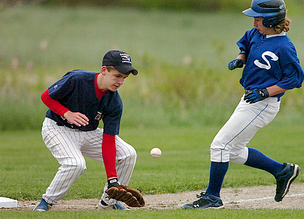 Bangor Christian's Rem Poulin (left) anticipates the ball as Searsport's Zach Beaudry shuffles to third base in the third inning of Monday's game, May 10, 2010 in Bangor. Searsport won 20-0. BANGOR DAILY NEWS PHOTO BY BRIDGET BROWN