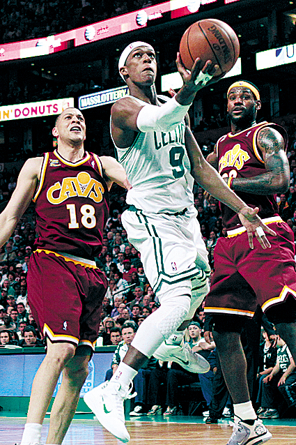 Boston Celtics guard Rajon Rondo (9) drives past Cleveland Cavaliers' Anthony Parker (18) and LeBron James, right, in the second half of Game 4 in a second-round NBA basketball playoff series in Boston Sunday, May 9, 2010.