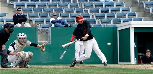 A player from Cincinnati- Clermont connects with the ball at one of the first baseball games  played at the newly revitalized park in Old Orchard Beach, Maine, on Monday, May 10, 2010. The Ballpark was home to the Triple-A Maine Phillies back in 1988 and is currently hosting the United States Collegiate Athletic Association 2010 National Baseball Tournament.( AP Photo/Pat Wellenbach)