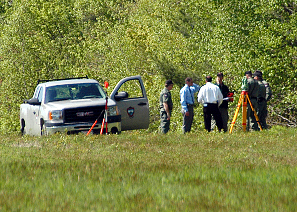 Maine Warden Service investigators gather at the scene as they investigate an accidental shooting of a LaGrange turkey hunter by another turkey hunter from his own party early Tuesday morning. BANGOR DAILY NEWS PHOTO BY NICK SAMBIDES JR.