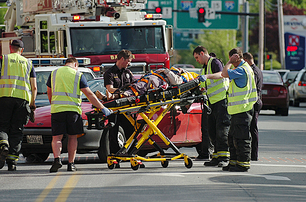 Emergency workers help transport into an ambulance a pedestrian who had been struck by a car while crossing Main Street at Buck Street around 5 p.m. Tuesday, May 11, 2010 in Bangor. BANGOR DAILY NEWS PHOTO BY BRIDGET BROWN