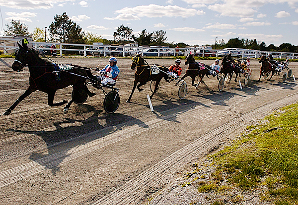 Drivers and their horses round the track on the first lap of race three during opening day of harness racing at Hollywood Slots Hotel & Raceway Tuesday afternoon, May 11, 2010. BANGOR DAILY NEWS PHOTO BY JOHN CLARKE RUSS