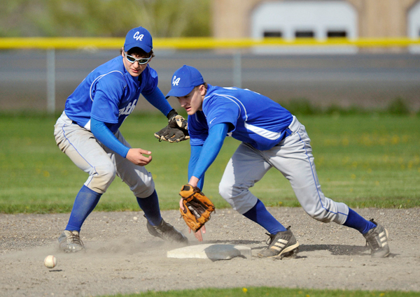 CAHS shortstop Dan Brewer (left) and second baseman Brendan York scramble to pick up a dropped ball in the fourth inning on a forceout, The play was ruled an error.  BANGOR DAILY NEWS PHOTO BY MICHAEL C. YORK