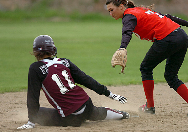 Central's Jocelyn Portmann(sp??) (right) reaches back in an attempt to tag Dover-Foxcroft's Jasmine Fletcher at second base in the fourth inning of Wednesday's game, May 12, 2010 in Corinth. BANGOR DAILY NEWS PHOTO BY BRIDGET BROWN
