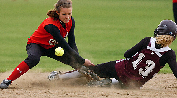 Central's Brianna Speed (left) aims to tag Dover-Foxcroft's Kelsey Barr (13) at second base in the fourth inning of Wednesday's game, May 12, 2010 in Corinth. BANGOR DAILY NEWS PHOTO BY BRIDGET BROWN