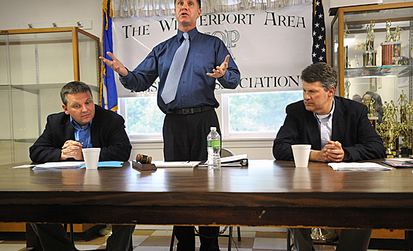 Bernie Littlefield (center) talks about the rules of the debate between Rep. Mike Thibodeau (left) and and Rep. John Peotti at the Grant Civic Center in Winterport Wednesday.  They debated about the tax question that will appear on the ballot on June 8. BANGOR DAILY NEWS PHOTO BY GABOR DEGRE