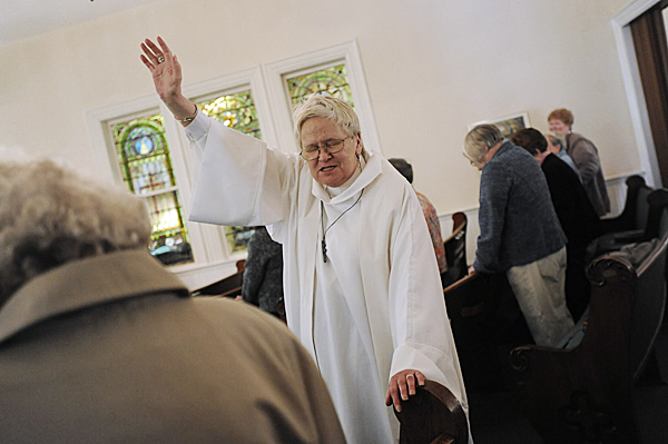 Rev. Lyn Bradley, pastor at First Congregational Church of Millinocket, delivers the benediction, standing with her parishioners at the conclusion of the service there Sunday, May 9, 2010. Rev. Bradley will receive her doctorate from Bangor Theological Seminary in Portland on May 21. BANGOR DAILY NEWS PHOTO BY JOHN CLARKE RUSS