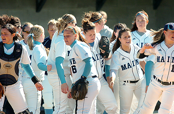 The University of Maine team including pitcher Cayleigh Montano (second from right), breaks from a huddle at the top of the second inning during their America East tournament game against Stony Brook on Thursday, May 13, 2010 in Orono. Maine won 5-1. (Bangor Daily News/Bridget Brown)