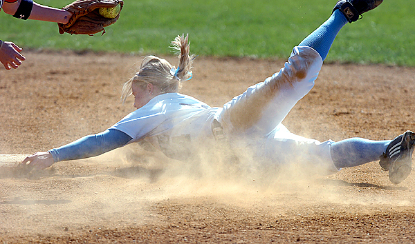 University of Maine freshman Chelsea Soule tries to hold onto second base as Stony Brook's Vicki Kavistsky tags her out in the second inning of their America East tournament game Thursday, May 13, 2010 in Orono. (Bangor Daily News/Bridget Brown)