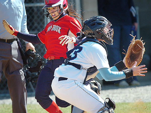 Stony Brook senior Crista Cerrone (left) prepares to slide into home plate as University of Maine catcher Stephanie George anticipates the throw in the second inning during their America East tournament game Thursday, May 13, 2010 in Orono. Cerrone scored the first run of the game but Maine went on to win 5-1. (Bangor Daily News/Bridget Brown)