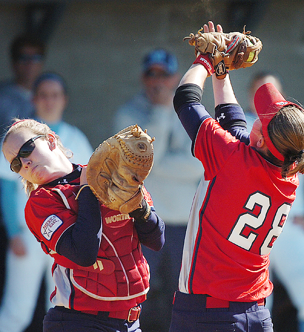 Stony Brook catcher Jade Clare (left) and first baseman Kendall Blumenthal combine for an out in the second inning on their America East tournament game against the University on Thursday, May 13, 2010 in Orono. Maine won 5-1. (Bangor Daily News/Bridget Brown)