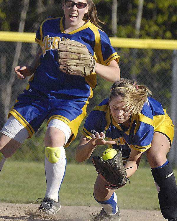 Hermon's Kristen Wilcox , (6), with encouragement from teammate Sam Schultz makes a last-second basket catch of an infield hit for the out in the fourth inning of their game versus Bucksport @ Hermon, Thursday, May 13, 2010. BANGOR DAILY NEWS PHOTO BY MICHAEL C. YORK