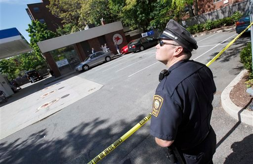 A Brookline police officer stands at the scene of an FBI  investigation at a service station in Brookline, Mass., Thursday, May 13, 2010, in connection with the attempted New York Times Square car bombing. (AP Photo/Michael Dwyer)