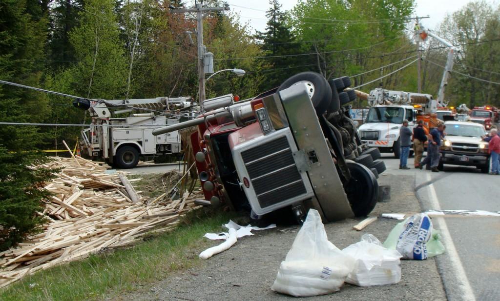 Benoit Lachance, 26, of St. Martin, Quebec, escaped injury Friday, May 14, 2010, when he lost control of his tractor trailer that was loaded with lumber on a  Route 15 curve in Moosehead Junction Township. Police were tied up at  the scene for most of the day until the company Lachance was hauling for  arrived with a wrecker and another tractor trailer from Quebec. (Bangor  Daily News Photo by Diana Bowley)
