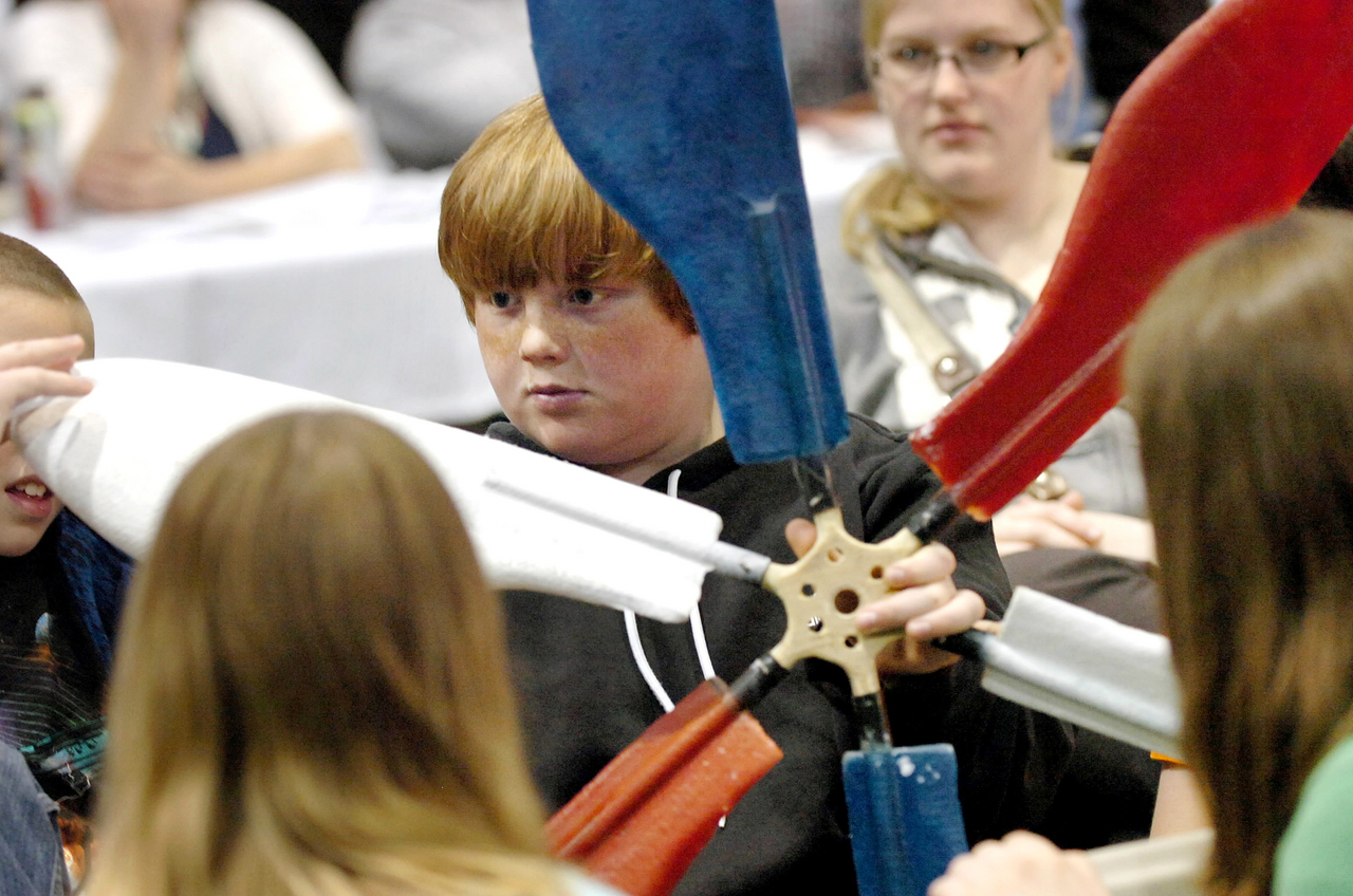 "Old Town Elementary School fifth-grader Tylor Paradis, (COPY DESK: HIS FIRST NAME IS SPELLED ""TYLOR"" NOT ""TYLER"") 11, examines a wind blade made by Old Town High School students during the Maine Wind Blade Challenge at the University of Maine on Friday, May 14, 2010 in Orono. More than 40 teams of students from around the state competed for the best wind blade design at the second annual event.  BANGOR DAILY NEWS PHOTO BY BRIDGET BROWN"