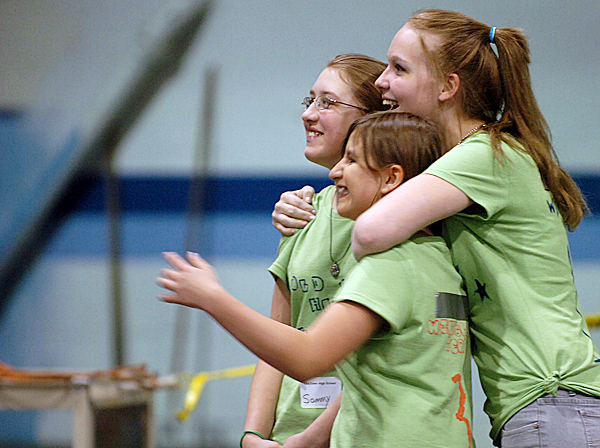 Old Town High School freshmen (from left) Samantha Emerson, 14, Abby Grindle, 14, and Carlee-Rae Hamilton, 15, react as their wind blade is tested during the Maine Wind Blade Challenge at the University of Maine on Friday, May 14, 2010 in Orono. More than 40 teams of students from around the state competed for the best wind blade design at the second annual event.  BANGOR DAILY NEWS PHOTO BY BRIDGET BROWN