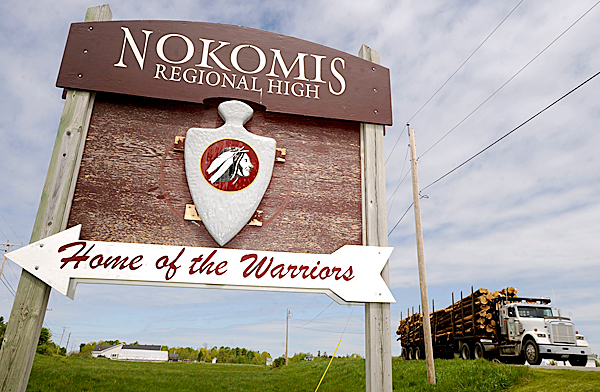 Nokomis Regional High School sign, displaying  its Native American image and &quot warrior&quot nickname, stands in ithe median between Williams Road and Newport Road in Newport, Maine. &quotWe want to be respectful and dignified without having caricatures or undignified acts &quot says the school's principal Mary Nadeau of the school's Native American icon and &quotwarrior'' nickname. &quotThis can provide a good teaching opportunity, &quot she added. BANGOR DAILY NEWS PHOTO BY JOHN CLARKE RUSS