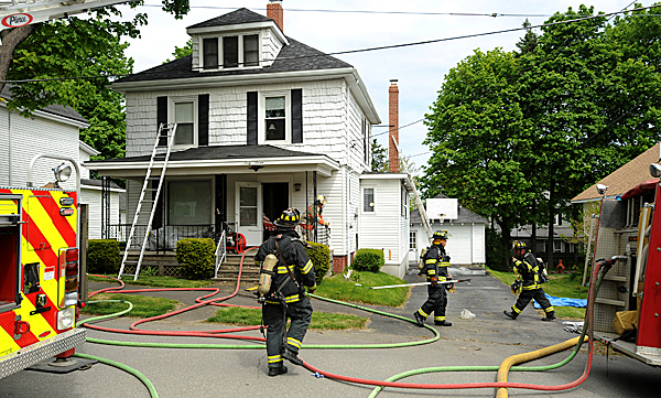 Firefighters quickly extinguished a fire at 67 Poplar Street in Bangor Friday morning.  An off-duty firefighter who lives in the area saw smoke coming from the building and called 911. BANGOR DAILY NEWS PHOTO BY GABOR DEGRE