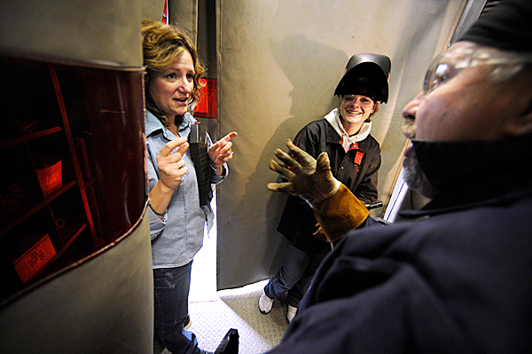 Student Sasha Bryant (center), 26, of Hollis huddles with Women's Unlimited program director Trisha Mosher,left, and welding instructor Ron Guimond of the New England School of Metal Work while Bryant was learning welding basics inside the New England School of Metalwork's Mobile Weld Training Center trailer which was parked in Bangor's Target Indiustrial Park Friday. Bryant and other area women, many of whom have never welded before, are participating in Women Unlimited's Construction Boot Camp which aims at preparing women for work in construction trades.  BANGOR DAILY NEWS PHOTO BY JOHN CLARKE RUSS