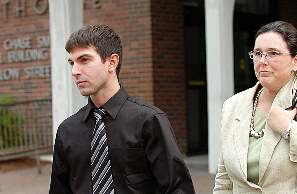 Derek Stansberry of Riverview, Fla. leaves U.S. District Court in Bangor on Friday, May 14, 2010 with Federal Public Defender Virginia Villa after he was released on $20,000 bail. Stansberry faces charges after he passed along a note that said he had a fake passport and told federal air marshals that he had dynamite aboard a Paris-to-Atlanta flight on April 27, according to prosecutors.  BANGOR DAILY NEWS PHOTO BY BRIDGET BROWN