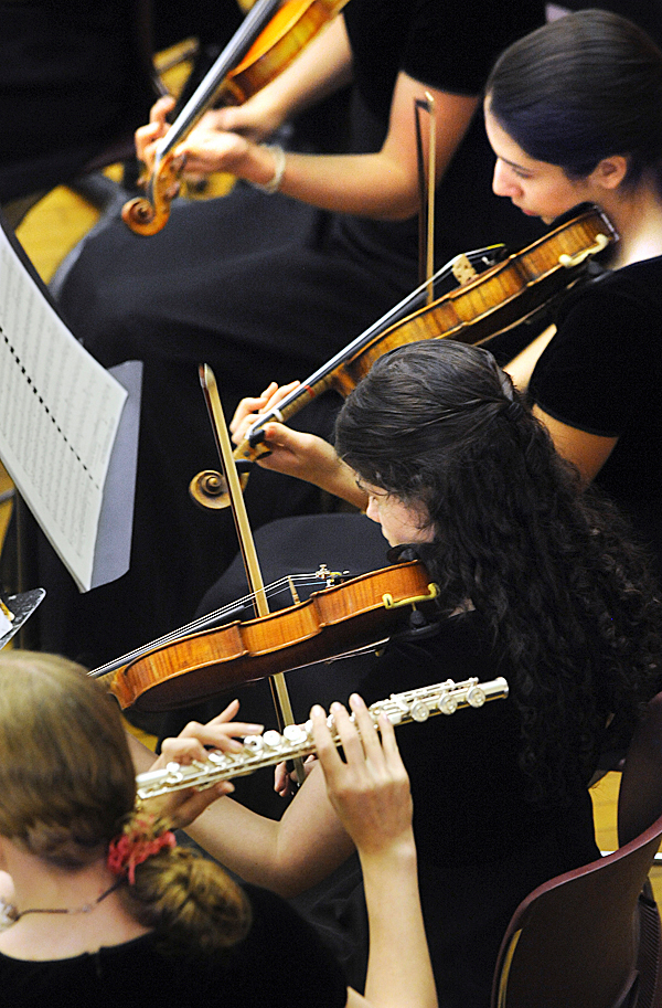 Members of the John Bapst High School Chamber Ensemble perform during the annual Spring Concert at the School in Bangor Sunday.  The concert was dedicated to long time english teacher Fred Jones who passed away Saturday. BANGOR DAILY NEWS PHOTO BY GABOR DEGRE