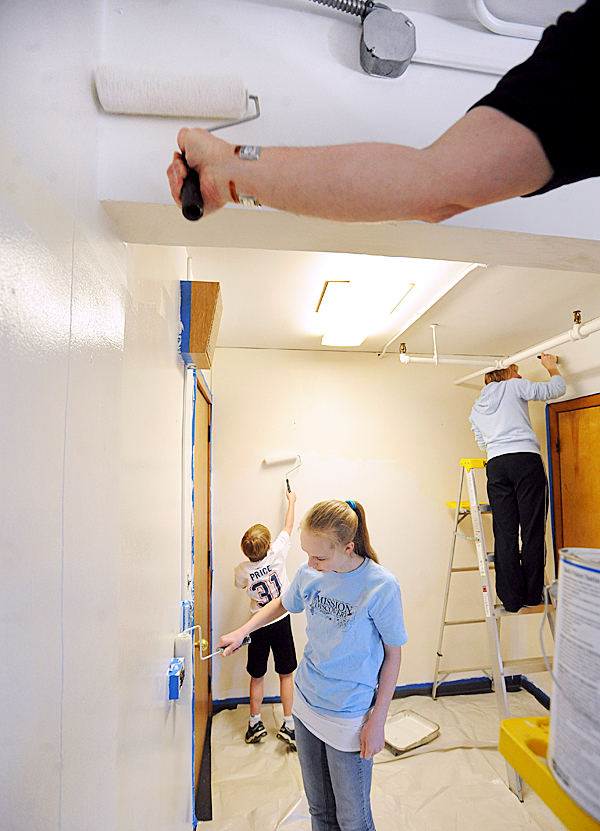 Volunteers paint one of the class rooms at the Vine Street School in Bangor Sunday.  About 200 people from five Bangor area churches cleaned up playgrounds, flower gardens and painted some rooms in five schools and and the Bangor Public Library.  Organizer Renee Garrett hopes to make &quotLabor for Your Neighbor&quot a semi-annual event that can give some much needed facelift to schools while the city is struggling with budget problems. BANGOR DAILY NEWS PHOTO BY GABOR DEGRE