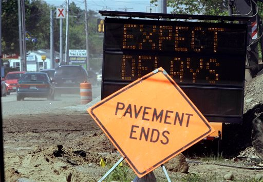 Vehicles pass a construction sign warning of delays on a road under construction in Brunswick, Maine, on Wednesday,  May 12, 2010. Maine voters will be asked to authorize four bond issues totaling more than $108 million in the June 8 primary.( AP Photo/Pat Wellenbach)