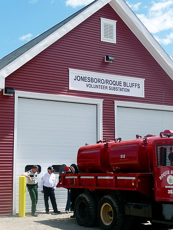 A pumper truck, donated by the Bristol, Maine, Fire Department, and a forest truck provided by the Maine Forest Service, sit outside the new Roque Bluffs Fire Station. The building was constructed with a Community Development Block Grant and hundreds of volunteer hours. Hanscom Construction of Marshfield, Coastal Maine General Contracting of Machias, CES Inc. of Machias, Border Electric of Calais and J.L. Huntley Inc. Plumbing and Heating of Machias worked on the two-story building. A dedication ceremony for the fire station was held Sunday and dozens of local folks turned out. BANGOR DAILY NEWS PHOTO BY SHARON KILEY MACK