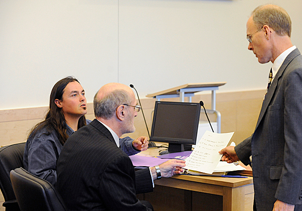 Defendant Christian &quotWill&quot  Neils, left, and his attorney Leonard Sharon of Auburn confer with Penobscot County deputy district attorney Michael Robert, right,  before the start of Neils' jury trial at Penobscot Judicial Center Monday, May 17, 2010. Neils , a member of the Native Forest Network, was among several people arrested at the Land Use Regulatory Commission's meeting in Bangor on Sept. 23, 2009. Neils faces charges of refusing to submit to arrest, disorderly conduct and carrying a concealed weopon, a knife. BANGOR DAILY NEWS PHOTO BY JOHN CLARKE RUSS