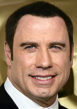 Actor John Travolta poses backstage at the Oscars during the 78th Academy Awards Sunday, March 5, 2006, in Los Angeles. (AP Photo/Kevork Djansezian)
