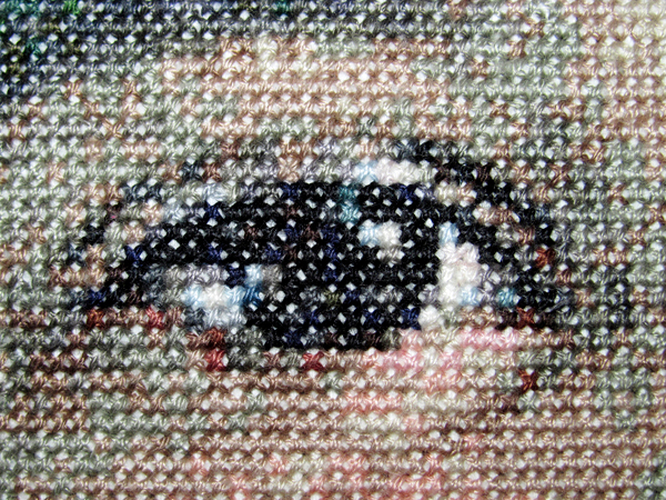 This cross-stitched portrait of Alyson Jean Nightingale at age 5 consumed more than five months and 104 skeins of thread ... and 125,440 stitches ...... in 48 different hues... with 18 different colors in each eye.    BANGOR DAILY NEWS PHOTO BY CHRISTOPHER COUSINS