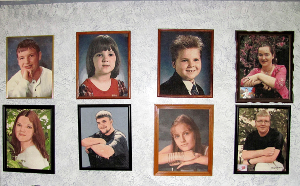 These are cross-stitched portraits of eight of Donna Provost's grandchildren. Each one took some 800 hours to complete. BANGOR DAILY NEWS PHOTO BY CHRISTOPHER COUSINS