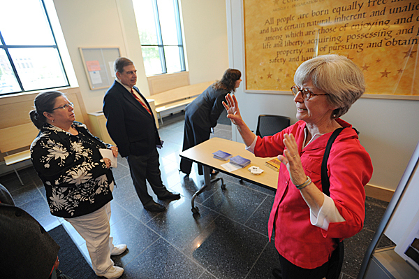 Local artist Jan Owen, right, talks to a small group of people about her art work as they tour the new Penobscot Judicial center in Bangor on Tuesday, May 18, 2010. Owen's and two other artists' work grace the halls of the recently-completed building. BANGOR DAILY NEWS PHOTO BY KEVIN BENNETT