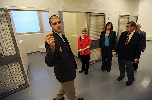 Judicial Marshal Darren Nadeau, left,  looks around as he gives a tour of the holding area that temporarily houses prisoners at the Penobscot Judicial Center to a small group of dignitaries on Tuesday, May 18, 2010. BANGOR DAILY NEWS PHOTO BY KEVIN BENNETT