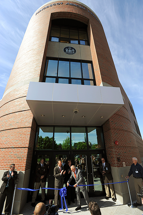 Gov. John Baldacci watches as Maine Supreme Court Justice Warren Silver cuts a blue ribbon in front of the Penobscot Judicial Center in Bangor on Tuesday, May 18, 2010. After a dedication ceremony on the second floor, tours of the new building were offered to those in attendance. BANGOR DAILY NEWS PHOTO BY KEVIN BENNETT