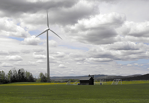 The wind turbine at the University of Maine at Presque Isle looms over the soccer and baseball fields at the college on Saturday. In May, 2009, the college became the first university in the state to install a mid-size wind turbine on campus. One year later,campus official say that the 600 kW wind turbine is saving both energy and money, and its installation has led the campus to explore other ways to be greener. BANGOR DAILY NEWS PHOTO BY JEN LYNDS