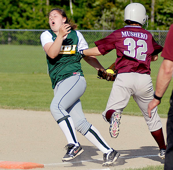 Mattanawcook Academy's Morgan Mushero hits MDI's #8 Aggie Burton as she crosses first base.  Burton keeps control of the ball and Mushero is out. BANGOR DAILY NEWS PHOTO BY LINDA COAN O'KRESIK