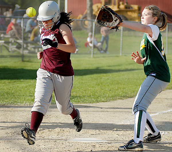 Mattanawcook Academy's Ashley Crosby (#13) steals home in the 5th inning after a wild pitch by MDI'S #12 Allysa Young (right) who covers home plate. BANGOR DAILY NEWS PHOTO BY LINDA COAN O'KRESIK