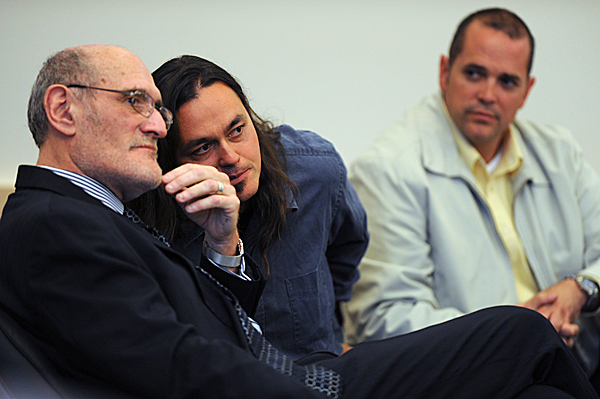 Christian &quotWill&quot  Neils, center, whispers in the ear of his attorney, Leonard Sharon, left, of Auburn, as private investigator Gary Baillargeon, right, watches after Sharon presented closing arguments on Wednesday, May 19, 2010, at the Penobscot Judicial Center. Neils, a member of the Native Forest Network, was among several people arrested at the Land Use Regulatory Commission's meeting in Bangor on Sept. 23, 2009. Neils faces charges of refusing to submit to arrest, disorderly conduct and carrying a concealed weapon, a knife. BANGOR DAILY NEWS PHOTO BY KEVIN BENNETT