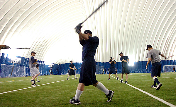 Members of the Maine baseball team including freshman Tyler Patzalek (center) warm up on their swing during practice inside the Mahaney Dome at the University of Maine in Orono on Wednesday, May 19, 2010. BANGOR DAILY NEWS PHOTO BY BRIDGET BROWN