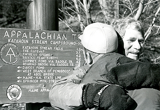 Blind hiker Bill Irwin of N. Carolina is hugged by a family member Nov. 21, 1990 at the end of his 2,000 mile hike of the Appalachian Trail in Baxter State Park. The blind hiker and his god Orient left Georgia in March and completed the trip at Mt. Katahdin 257 days later. (Bangor Daily News File Photo)