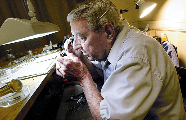 Andy Taber, 82, carefully works on a watch at his shop, Taber's Watch Repair Service in Bangor. The delicate work takes infinate patience and the touch of a true master craftsman. News photo by Stephen M. Katz PowerPC 3/4