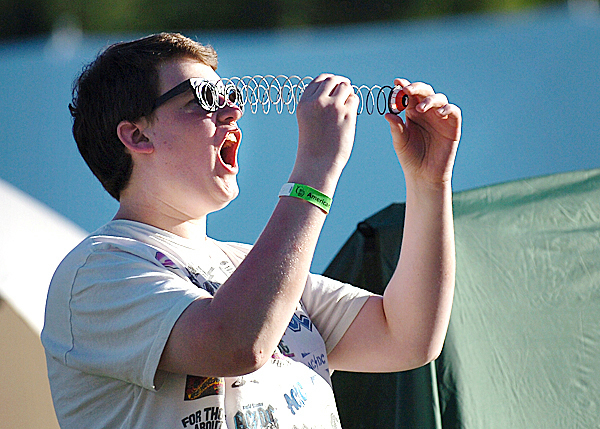 Jason Smith, 16, of Lincoln amuses himself with friends from Mattanawcook Academy who were participating in the Relay for Life at the Old Town High School track Friday, May 21, 2010. Smith and fellow high school students were participating in the 17th annual event in honor of calculus teacher Christina Doore.  BANGOR DAILY NEWS PHOTO BY BRIDGET BROWN